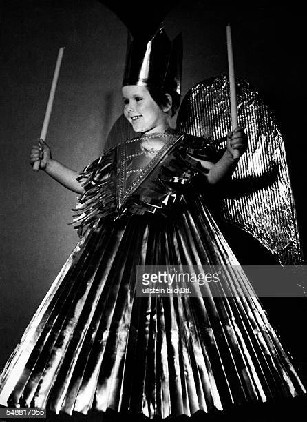A little girl as Nuremberg tinsel angel 1938 Photographer Hedda Walther Vintage property of ullstein bild