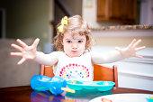 Little girl at the dinner table