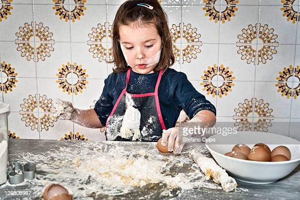 Little girl at work in the kitchen