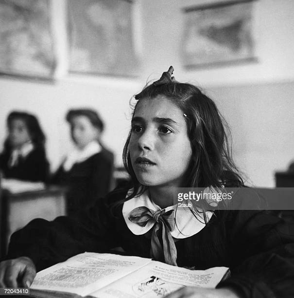 A little girl attends school at Borgo Petilia in Caltanissetta in central Sicily circa 1950