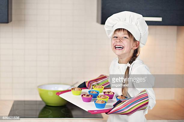 Little girl baking cupcakes