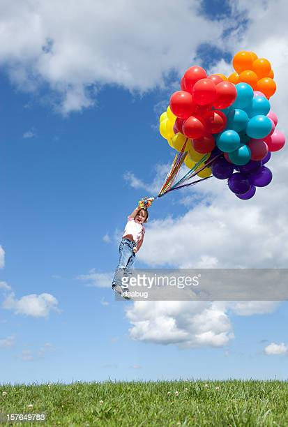 Little Girl Being Blown Away While Holding Bunch of Balloons
