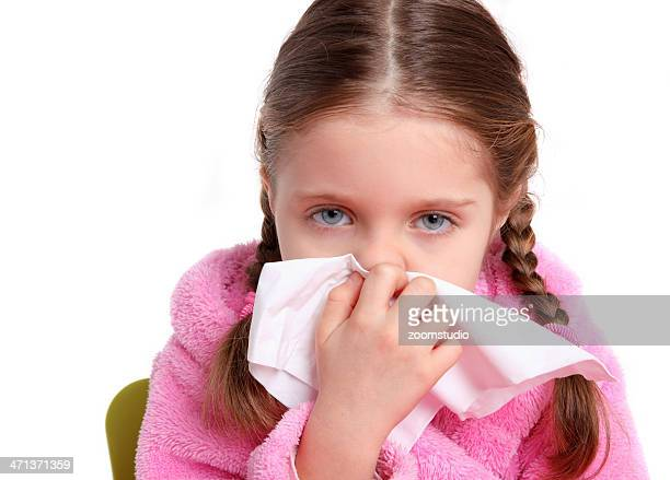 Little girl blow her nose