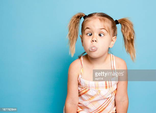 Little Girl Blowing Bubbles with her Bubble Gum