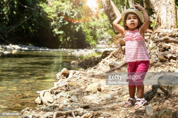 Little girl by water stream in The Daintree National Park, Queensland, Australia