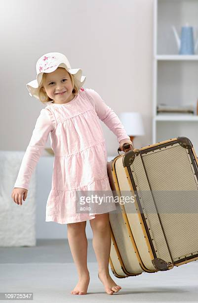 Little Girl Carrying Large Classic Suitcase
