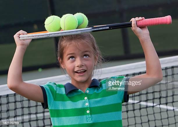 Little Girl Carrying Tennis Balls