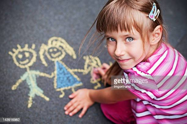 Little girl chalking