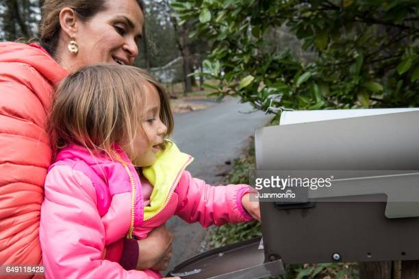 Little girl checking a mailbox