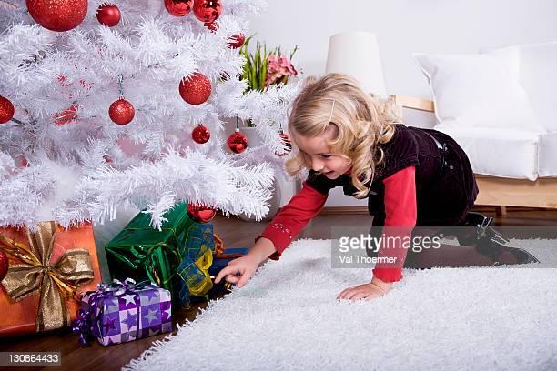 Little girl choosing a Christmas gift
