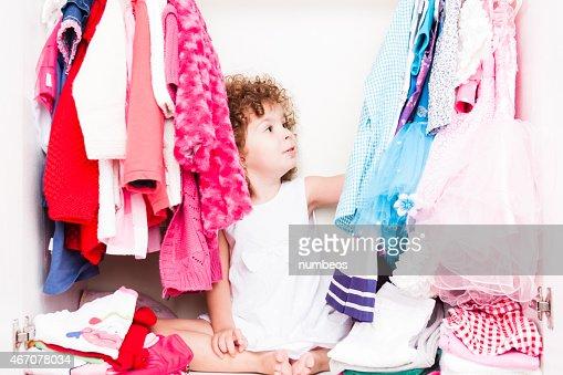 Little girl choosing her clothes