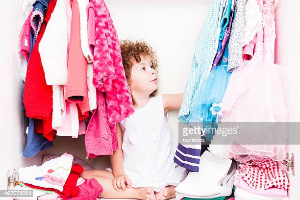 Little girl choosing her clothes