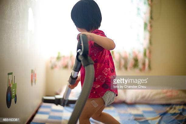 little girl cleaning house