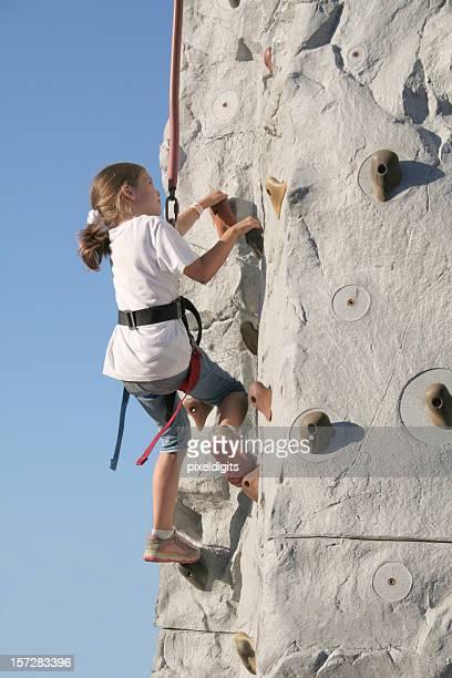 Little Girl Climbing A Wall