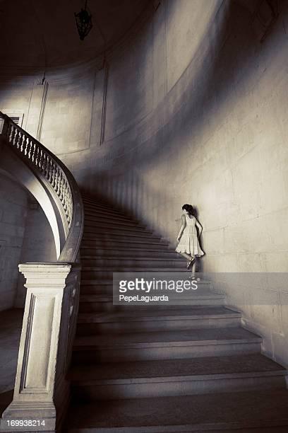 Little girl climbing staircase