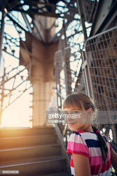 Little girl climbing stairs of Eiffel Tower