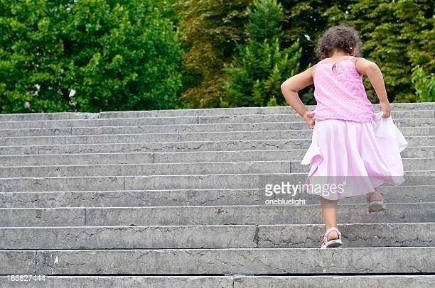 Little Girl (5-6) Climbing Stairs Outdoors, Horizontal