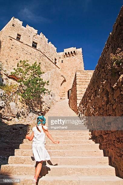 Little girl climbing to the Lindos Acropolis