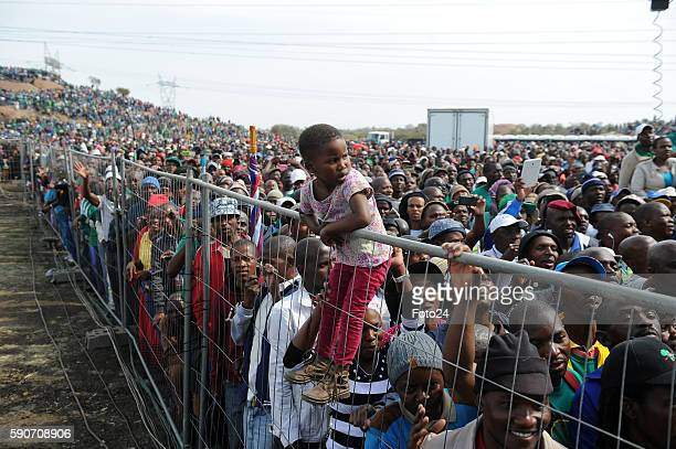 A little girl clings on a fence for a better view during the commemoration of the 2012 Marikana massacre on August 16 2016 in Rustenburg South Africa...