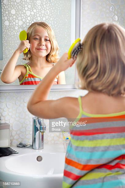 Little girl combing