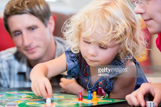 Little girl contemplating her next game move