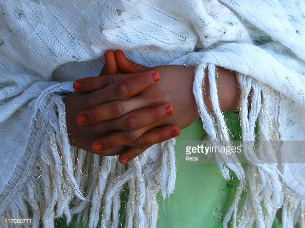 A little girl crossing her hands tinged with henna May 17 2009 in the Takhar Province Afghanistan