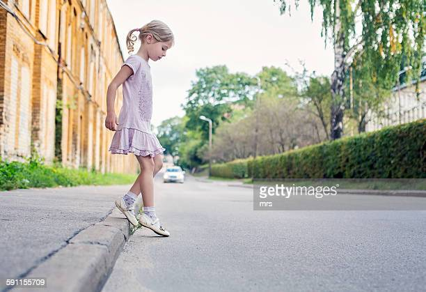 Little girl crossing the street