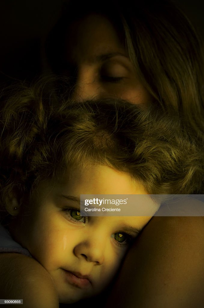 Little girl crying on her mother's arms : Stock Photo