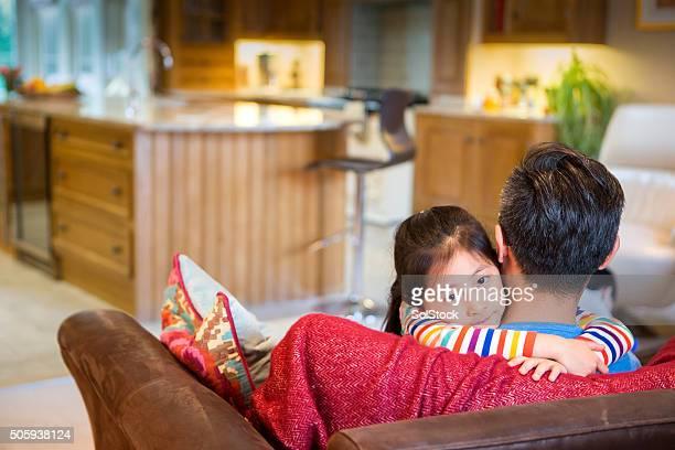 Little Girl Cuddling Her Dad