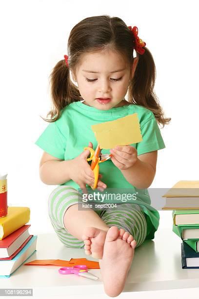 Little Girl Cutting Paper