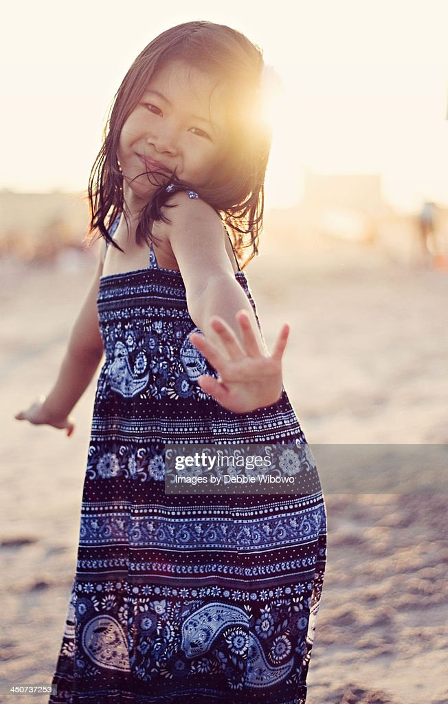 A little girl dancing during sunset
