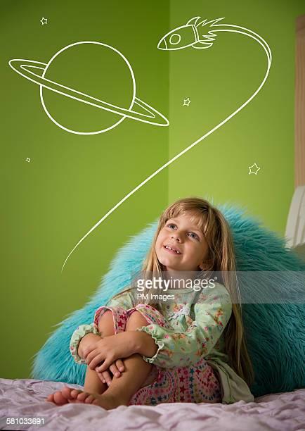 Little girl day dreaming