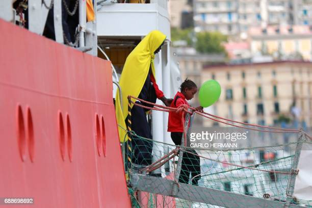 A little girl disembarks from the Aquarius rescue Ship run by NGO SOS Mediterranee and Medecins Sans Frontieres in the port of Salerno after a rescue...