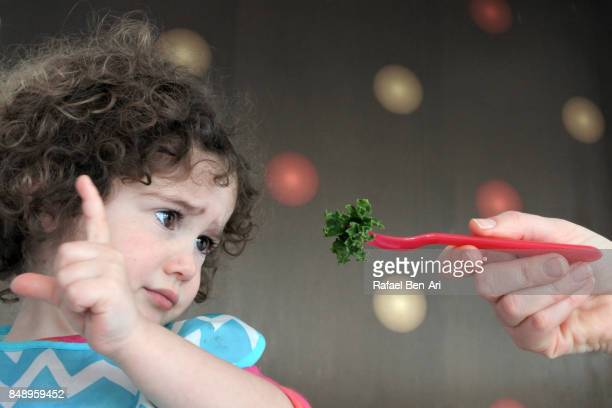 Little girl doesn't want to eat healthy food