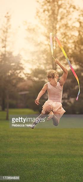 little girl doing rhythmic gymnastics