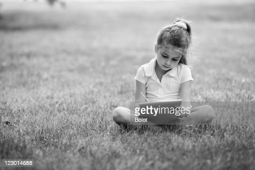 Little girl drawing in park : Stock Photo