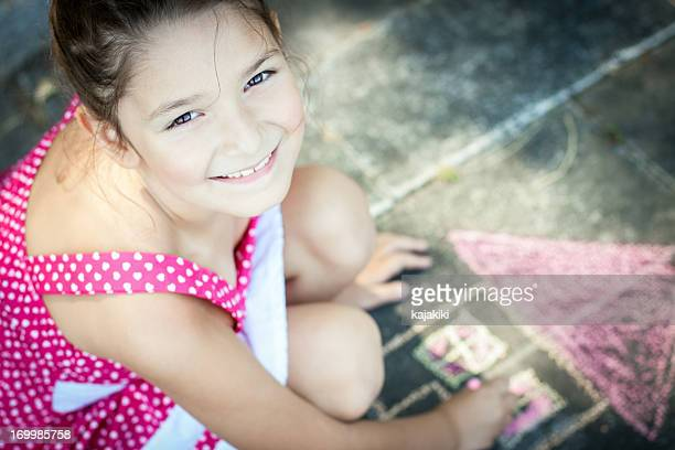 Little Girl Drawing on the sidewalk
