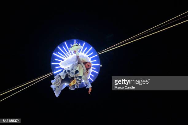 A little girl dressed as an angel is roped with ropes from a palace to simulate the flight during the feast in honor of the Our Lady of Peace the...