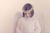 Little girl dressed as angel