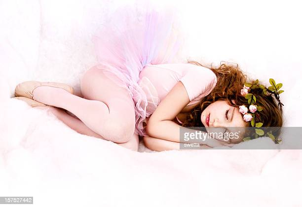 Little girl dressed in a fairy costume, sleeping