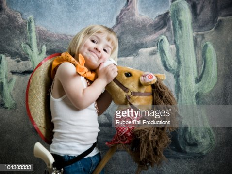 little girl dressed up as a cowgirl : Stock Photo