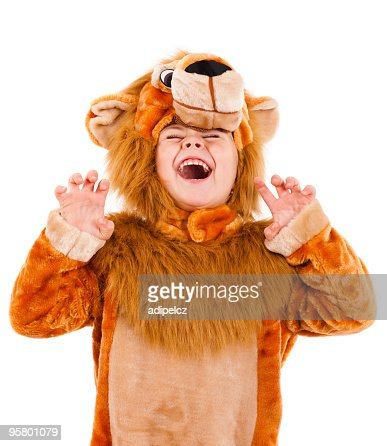A little girl dressed up in a lion costume