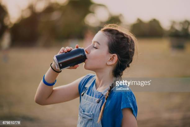 Little Girl Drinking a Soda