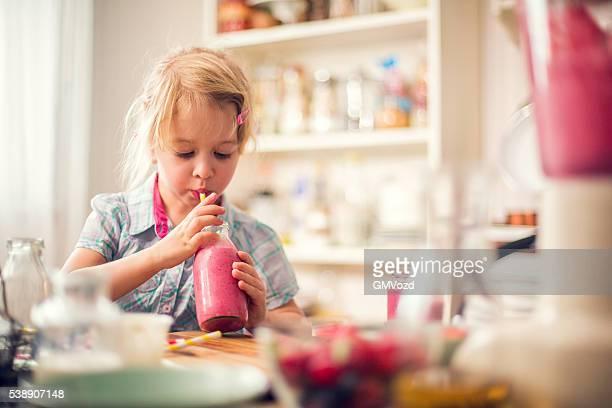 Little Girl Drinking Fresh Smoothie