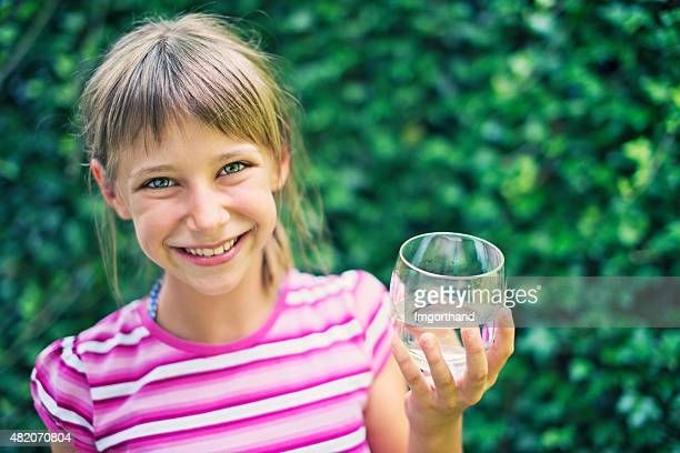 Little girl drinking glass of water