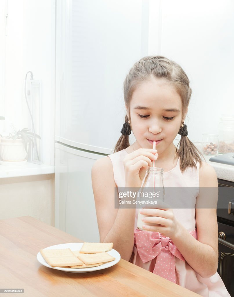 Little girl drinking milk : Stock Photo