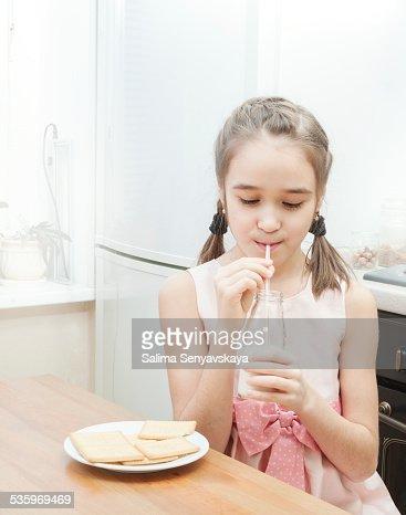 Little girl drinking milk : Stock Photo