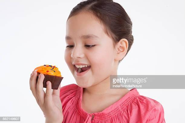 Little girl eating a cupcake