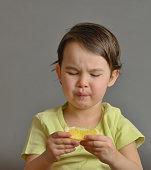 little girl eating a lemon