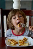 Little girl eating a waffle